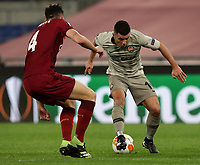 Football Soccer: Europa League -Round of 16 1nd leg AS Roma vs FC Shakhtar Donetsk, Olympic Stadium. Rome, Italy, March 11, 2021.<br /> Shakhtar Donetsk's Junior Moraes (R) in action with Roma's Bryan Cristante (L) during the Europa League football soccer match between Roma and  Shakhtar Donetsk at Olympic Stadium in Rome, on March 11, 2021.<br /> UPDATE IMAGES PRESS/Isabella Bonotto