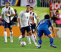 U.S. midfielder Clint Dempsey (8, white) takes on Italian midfielder Gennaro Gattuso (8, blue). The USA and Italy played to a 1-1 tie in their FIFA World Cup Group E match at Fritz-Walter-Stadion, Kaiserslautern, Germany, June 17, 2006.