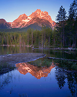 Sunrise light on Mt. Moran reflected in Jackson Lake viewed from Grassy Island; Grand Teton National Park, WY