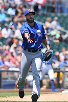Round Rock Express relief pitcher Brady Dragmire (55) tosses the ball to first base for a putout during a game against the Omaha Storm Chasers at Werner Park on May 29, 2017 in Omaha, Nebraska.  Omaha won 10-8.  (Dennis Hubbard/Four Seam Images)