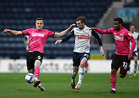 20th April 2021; Deepdale, Preston, Lancashire, England; English Football League Championship Football, Preston North End versus Derby County; George Edmundson of Derby County controls the ball under pressure from Tom Barkhuizen of Preston North End
