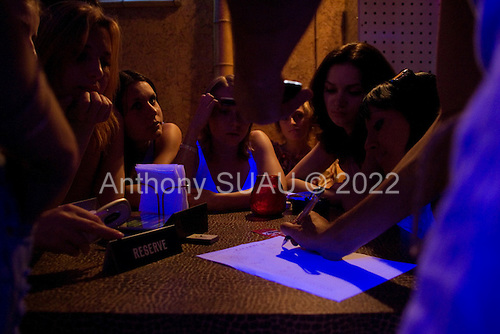 Kiev, Ukraine<br /> May 30, 2005 <br /> <br /> Tato night club where young girls come to try out every Monday night in dreams of becoming models, dancers or what ever else.