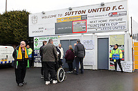 Fans queue at the entrance awaiting the turnstiles to be opened during Sutton United  vs Leeds United, Emirates FA Cup Football at the Borough Sports Ground on 29th January 2017