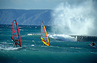 Two men windsurfing in strong winds at Prado beach, Marseille, France.