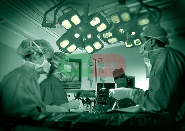 surgical team gathered around operating table, green duotone