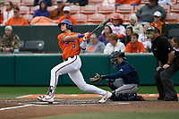 Center fielder Bryce Teodosio (13) of the Clemson Tigers bats in a game against the South Alabama Jaguars on Opening Day, Friday, February 15, 2019, at Doug Kingsmore Stadium in Clemson, South Carolina. The catcher is Carter Perkins and the umpire is Craig Barron. Clemson won, 6-2. (Tom Priddy/Four Seam Images)