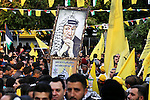 Palestinian Fatah supporters celebrate during a rally as they mark the 51st anniversary of the founding of the Fatah movement, in Gaza City December 31, 2015. Photo by Mohammed Asad