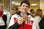 Ottawa, ON - March 28 2014- Sledge hockey player Ben Delaney shows off his bronze medal from the Sochi 2014 Paralympic Games (Photo: Patrick Doyle/CIBC)