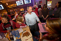NWA Democrat-Gazette/JASON IVESTER<br /> Colby Hale, head coach, and Arkansas soccer players watch the selection show on Monday, Nov. 7, 2016, at Sassy's Barbeque & Grille in Fayetteville. The Razorbacks will host Memphis on Friday in the first round of the NCAA tournament.