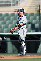 Greenville Drive catcher Austin Rei (13) gives defensive signs during the game against the Kannapolis Intimidators at Intimidators Stadium on June 7, 2016 in Kannapolis, North Carolina.  The Drive defeated the Intimidators 4-1 in game one of a double header.  (Brian Westerholt/Four Seam Images)