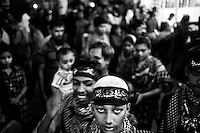 Bangladeshi Shiite Muslims attend mourning procession on the day before Ashura at Hoseni dalan.  Shiites mark Ashura, the tenth day of the month of Muharram, to commemorate the Battle of Karbala when Imam Hussein, a grandson of Prophet Muhammad, was killed. Dhaka, Bangladesh. Nov. 3, 2014