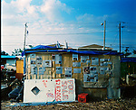 At 62nd Street and 17th Avenue in Miami lies Umoja Village. It is on the west side of I-95. Max Rameau a community leader built the shanty town in response to the county housing scandal where developers were stealing millions of dollars earmarked for affordable housing. Over 60 people are living in the village made up of pallets and old sofa's. Among the residents is Gypsy Bird a homeless poet. Gypsy is the son of Bobby Sands a famous guitarist on cruise ships in Miami. His mother is Alice a housewife. Gypsy has three brothers and a sister.  He is disabled and receives no money from the government. Born in Virginia 58 years ago.
