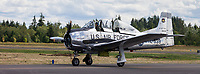 Silver T-28A Trojan US Fighter Aircraft, Arlington Fly-In 2016, WA, USA.