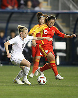 Amy Rodriguez #8 of the USA WNT moves away from Shanshan Qu #19 of the PRC WNT during an international friendly match at PPL Park, on October 6 2010 in Chester, PA. The game ended in a 1-1 tie.