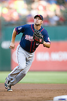 Minnesota Twins first baseman Michael Cuddyer #5 tracks a foul ball during a Major League Baseball game against the Texas Rangers at the Rangers Ballpark in Arlington, Texas on July 27, 2011. Minnesota defeated Texas 7-2.  (Andrew Woolley/Four Seam Images)