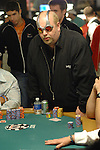 Jac Arama of London imakes a call and then reacts to winning the hand.