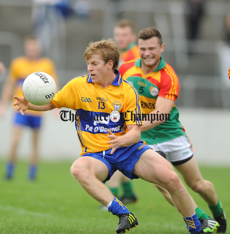 Podge Collins of Clare in action against Kieran Nolan of Carlow during their All-Ireland senior championship round 2B game at Dr. Cullen park. Photograph by John Kelly.