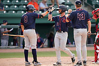 First baseman Evan Edwards (16) of the Bowling Green Hot Rods is greeted by Jonathan Aranda (8) and Peyton Battenfield (43) after scoring a run in a game against the Greenville Drive on Sunday, May 9, 2021, at Fluor Field at the West End in Greenville, South Carolina. (Tom Priddy/Four Seam Images)