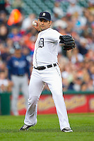 Detroit Tigers pitcher Anibal Sanchez (19) makes a throw to first base against the Tampa Bay Rays at Comerica Park on June 4, 2013 in Detroit, Michigan.  The Tigers defeated the Rays 10-1.  Brian Westerholt/Four Seam Images