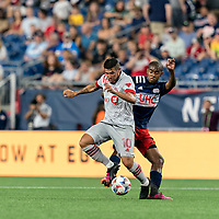 FOXBOROUGH, MA - JULY 7: Alejandron Pozuelo #10 of Toronto FC attempts to control the ball as Brando Bye #15 of New England Revolution defends during a game between Toronto FC and New England Revolution at Gillette Stadium on July 7, 2021 in Foxborough, Massachusetts.