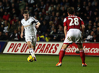 Tuesday, 28 January 2014<br /> Pictured: L -R Ben Davies of Swansea against Scott Parket of Fulham.<br /> Re: Barclay's Premier League, Swansea City FC v Fulham at the Liberty Stadium, south Wales.