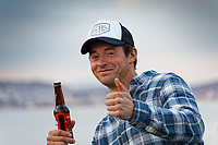 Pictured: A man enjoys a drink outdoors in Mumbles. Friday 16 April 2021<br /> Re: People enjoy an evening out after Covid-19 lockdown rules were relaxed, in Swansea Bay, Wales, UK.