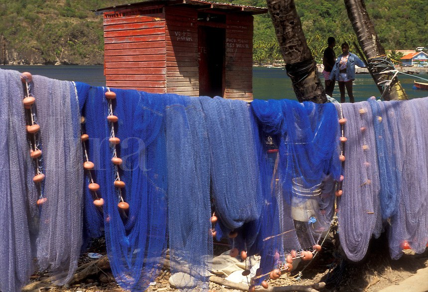 AJ2507, St. Lucia, Caribbean, fishing nets, Caribbean Islands, Blue fishing nets hang to dry on the beach of Choiseul in the sun on the island of Saint Lucia (a British Commonwealth member).