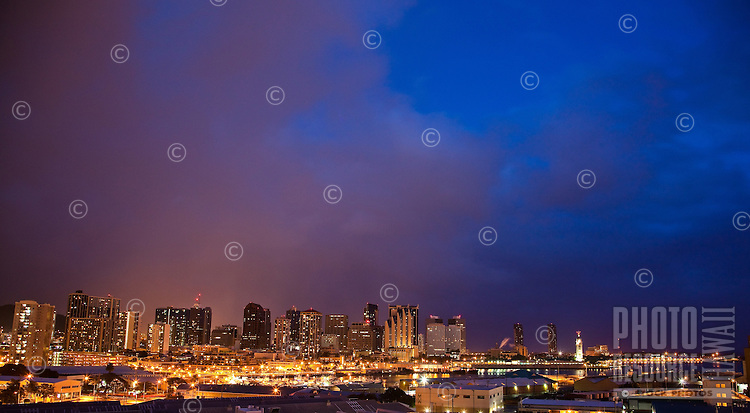 View of Dole Cannery and downtown Honolulu from above at dusk