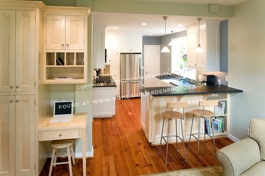 """Originally built in 1904, this Seattle farmhouse had endured a hodge-podge of on-the-cheap renovations and additions, including a family room addition and kitchen """"renovation"""" in the early 1990s. Eight years and two kids have happened since the homeowners purchased the home, and the """"first thing they were going to change"""" has finally made it to the top of the list of renovations. Needing to stick within the original footprint of less than 300 s.f. for a variety of reasons, small changes to doorways still allowed for greater space in the 135s.f. kitchen, a home office nook in the FR, and a more functional bathroom, all without sacrificing other areas. Custom faceframe cabinetry with cabinet latches, soapstone counters, and reclaimed heartpine flooring helped to take the home back to its roots."""
