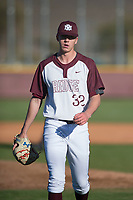 Mountain Ridge Mountain Lions starting pitcher Matthew Liberatore (32) walks off the field between innings of a game against the Boulder Creek Jaguars at Mountain Ridge High School on February 28, 2018 in Glendale, Arizona. Liberatore collected 14 strikeouts in his first appearance of the spring, leading the Mountain Lions to a 6-3 conference victory. (Zachary Lucy/Four Seam Images)