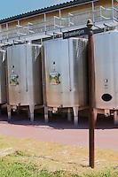 """Outside stainless steel fermentation tanks and a jocular street sign (from Denmark) that says """"Strandvejen"""" (the coastal road)  Chateau de Haux Premieres Cotes de Bordeaux  Entre-deux-Mers  Bordeaux Gironde Aquitaine France"""
