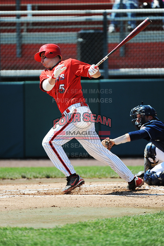 St. John's University Redstorm infielder Frank Schwindel (5) during game against the University of Notre Dame Fighting Irish at Jack Kaiser Stadium on May 12, 2013 in Queens, New York. St. John's defeated Notre Dame 2-1.      . (Tomasso DeRosa/ Four Seam Images)