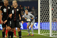 USWNT goalkeeper Nicole Barnhart positioning herself behind the wall.