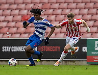 6th February 2021; Bet365 Stadium, Stoke, Staffordshire, England; English Football League Championship Football, Stoke City versus Reading; Ovie Ejaria of Reading has his shirt pulled back by Nathan Collins of Stoke City