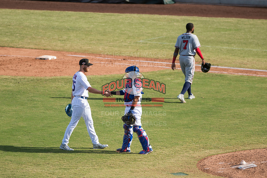 Mesa Solar Sox relief pitcher Bailey Clark (35) and P.J. Higgins (12), both of the Chicago Cubs organization, shake hands as Izzy Wilson (7) walks off the field after an Arizona Fall League game against the Peoria Javelinas at Sloan Park on October 24, 2018 in Mesa, Arizona. Mesa defeated Peoria 4-3. (Zachary Lucy/Four Seam Images)