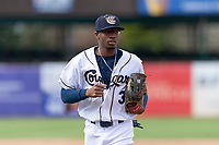 Kane County Cougars left fielder Tra Holmes (3) jogs off the field between innings of a Midwest League game against the Cedar Rapids Kernels at Northwestern Medicine Field on April 28, 2019 in Geneva, Illinois. Kane County defeated Cedar Rapids 3-2 in game one of a doubleheader. (Zachary Lucy/Four Seam Images)