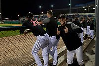 Batavia Muckdogs Sean Reynolds (right) finds another victim in the dugout, pitcher Easton Lucas (28) for the bubble gum prank during a NY-Penn League game against the State College Spikes on August 24, 2019 at Dwyer Stadium in Batavia, New York.  State College defeated Batavia 1-0.  (Mike Janes/Four Seam Images)