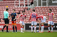 20th February 2021; Bet365 Stadium, Stoke, Staffordshire, England; English Football League Championship Football, Stoke City versus Luton Town; James Collins of Luton Town receives a yellow card