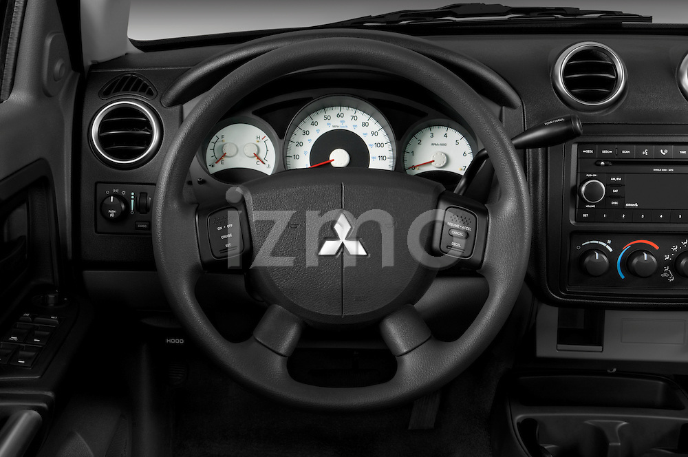 Steering wheel view of a 2008 Mitsubishi Raider pickup truck