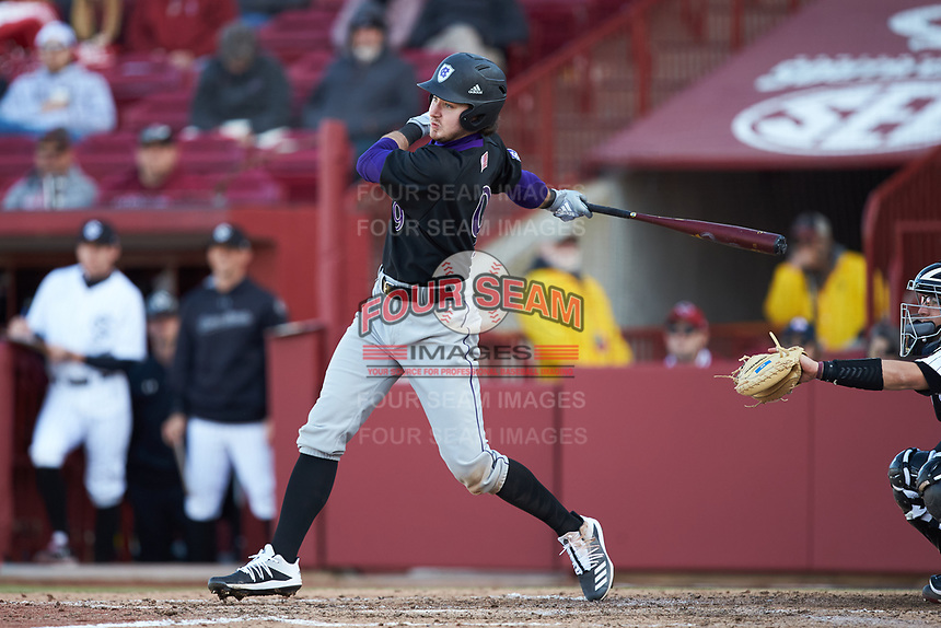 Austin Masel (9) of the Holy Cross Crusaders follows through on his swing against the South Carolina Gamecocks at Founders Park on February 15, 2020 in Columbia, South Carolina. The Gamecocks defeated the Crusaders 9-4.  (Brian Westerholt/Four Seam Images)