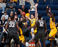 Jeff Powers of California tries to block the ball during 2014 National Invitation Tournament against Arkansas at Haas Pavilion in Berkeley, California on March 24th, 2014.  California defeated Arkansas, 75-64.