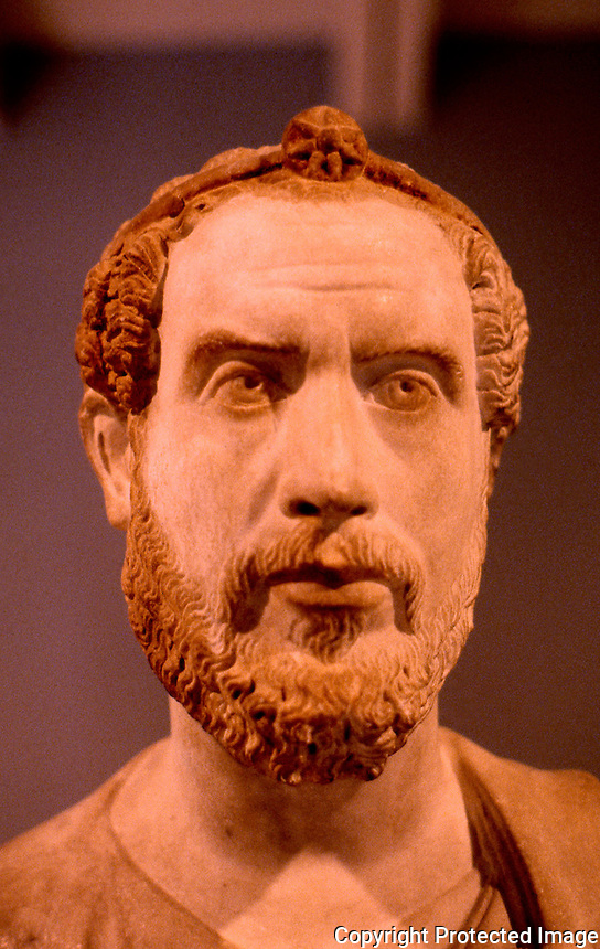 Greek Art:  Roman Portrait Bust--Priest of Serapis, ca. 180 A.D.  The gilded fillet with the 7-pointed star indicates his status as priest of Egyptian God Serapis.  J. Paul Getty Museum.