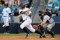 Tampa Yankees shortstop Ali Castillo #12 at bat in front of catcher Zach Maggard during a game against the Lakeland Flying Tigers at Steinbrenner Field on April 6, 2013 in Tampa, Florida.  Lakeland defeated Tampa 8-3.  (Mike Janes/Four Seam Images)