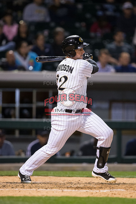 Matt Davidson (22) of the Charlotte Knights follows through on his swing against the Scranton\Wilkes-Barre RailRiders at BB&T BallPark on May 1, 2015 in Charlotte, North Carolina.  The RailRiders defeated the Knights 5-4.  (Brian Westerholt/Four Seam Images)