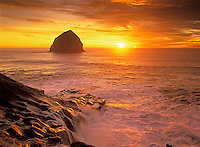 Sunset at Cape Kiwanda with wave covered rock. Oregon