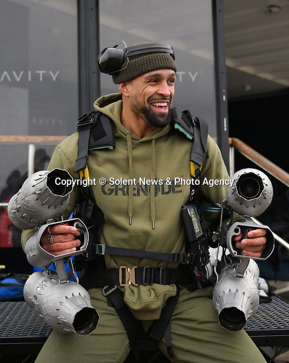 """Pictured: Member of dance troupe Diversity, Ashley Banjo testing out the Gravity jet suit at Goodwood Aerodrome. <br /> <br /> Dance troupe Diversity, known for flying through the air in their stage performances, today took to the air outside - with jetpacks strapped to their hands.  Diversity members including founder Ashley Banjo, Jordan Banjo and Perri Kiely, donned Gravity Industries' cutting edge human-flight suit and took to the skies powered by Grenade Energy.<br /> <br /> Ashley, 32, said: """"Ahead of the day we were certain Pel would smash it, he's annoyingly very good at pretty much everything he puts his energy into.  SEE OUR COPY FOR DETAILS.<br /> <br /> © Solent News & Photo Agency<br /> UK +44 (0) 2380 458800"""