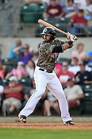 Arkansas Travelers third baseman Kaleb Cowart (21) at bat during a game against the San Antonio Missions on May 25, 2014 at Dickey-Stephens Park in Little Rock, Arkansas.  Arkansas defeated San Antonio 3-1.  (Mike Janes/Four Seam Images)