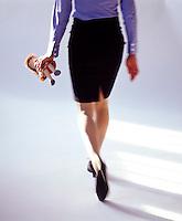 Woman walking with Raggedy Ann doll