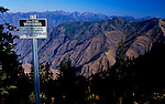 Danger sign says no driving over this cliff! into Hells Canyon.