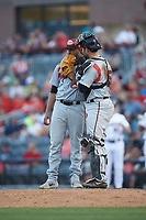 Carolina Mudcats catcher Payton Henry (15) has a meeting on the mound with starting pitcher Nelson Hernandez (48) during the game against the Fayetteville Woodpeckers at SEGRA Stadium on May 18, 2019 in Fayetteville, North Carolina. The Mudcats defeated the Woodpeckers 6-4. (Brian Westerholt/Four Seam Images)